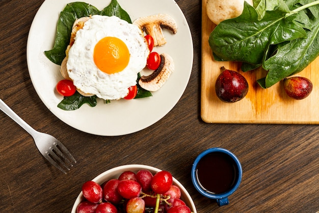 Fried egg breakfast with tomatoes  and coffee Free Photo
