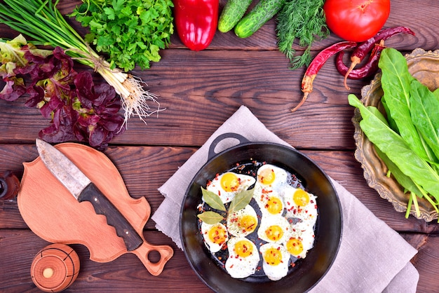 Fried egg and fresh vegetables and herbs Premium Photo