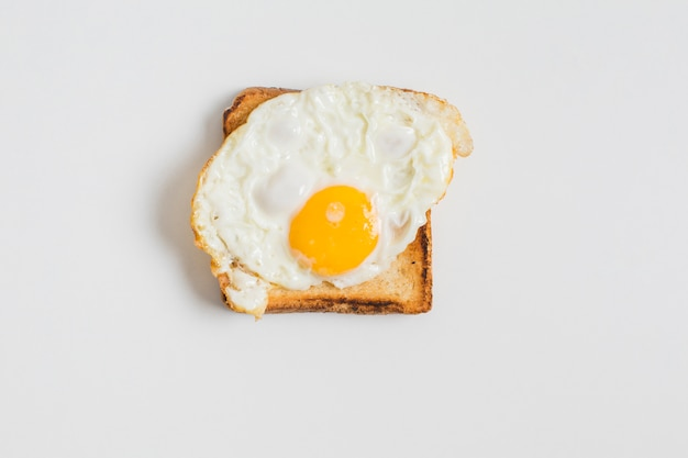 Fried egg on toast isolated on white background Free Photo