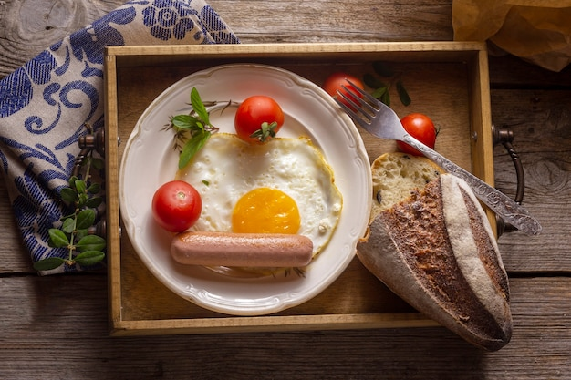 Fried egg with hotdog and bread Free Photo