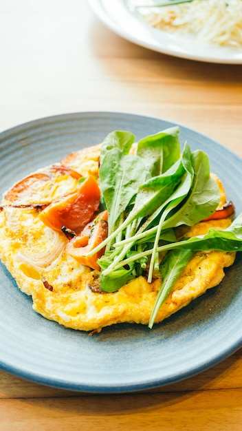 Fried eggs omelette in white plate Free Photo