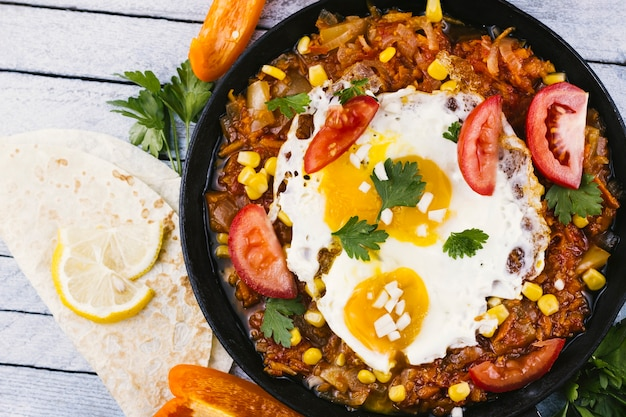 Fried eggs on traditional mexican dish Free Photo
