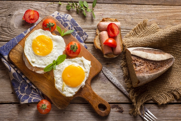 Fried eggs with bread and toast Free Photo