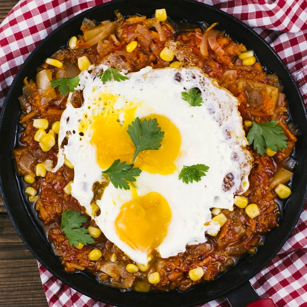 Fried eggs with mexican food in a pan Free Photo