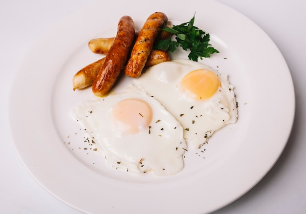 Fried eggs with sausages Free Photo