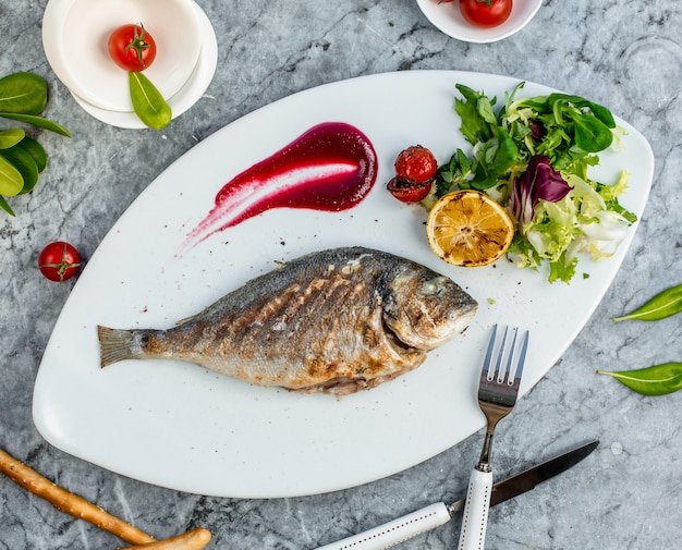 Fried fish with vegetables in the plate 4 Free Photo