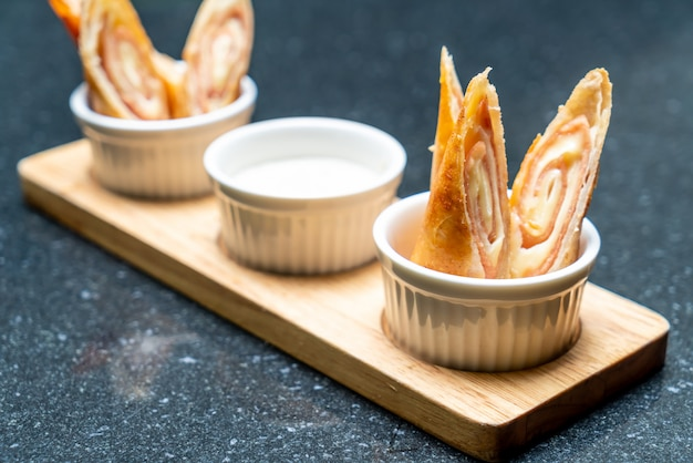 Fried ham and cheese spring rolls Premium Photo