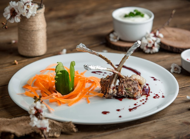 Fried meat with vegetablesin the plate Free Photo