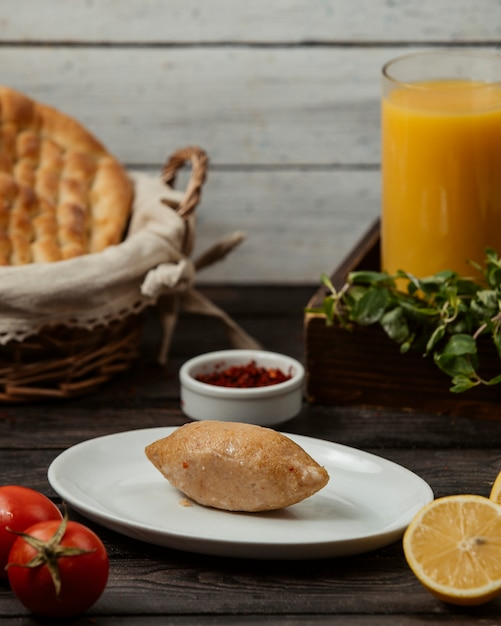 Fried pie with meat and orange fresh Free Photo