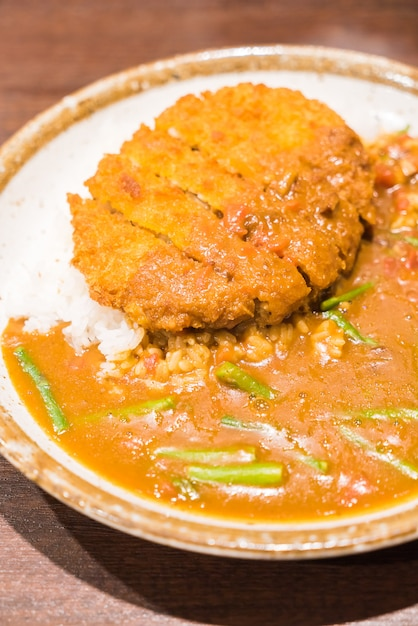 Fried pork with curry sauce Free Photo