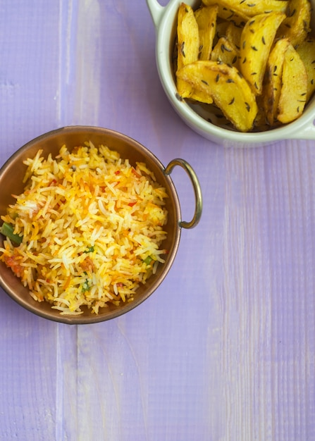 Fried potato and rice on table Free Photo