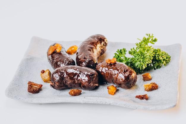 Жареные колбаски с разными специями Бесплатные Фотографии