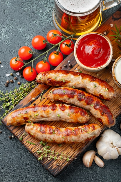 Fried sausages with sauces and herbs. Premium Photo
