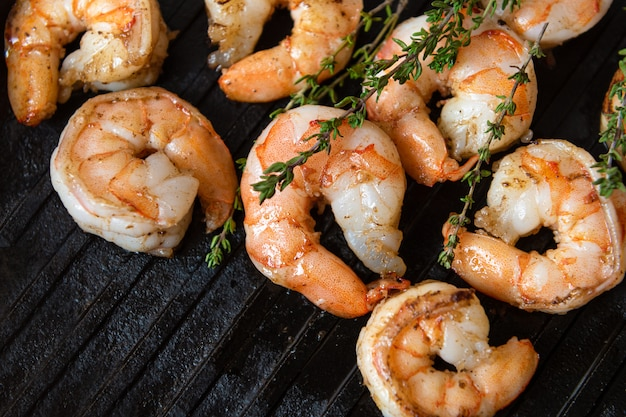 Fried shrimps with herbs, close up view. Free Photo