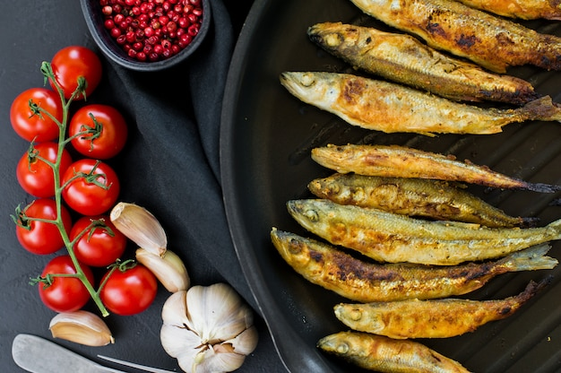 Fried smelt in a pan. Premium Photo