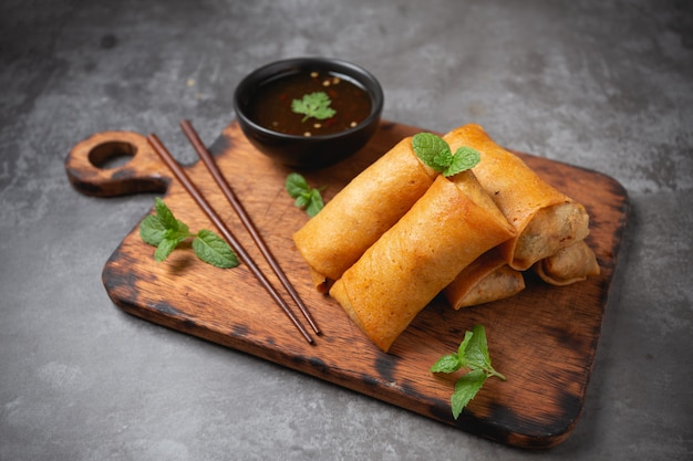 Fried spring rolls on cutting board. Free Photo