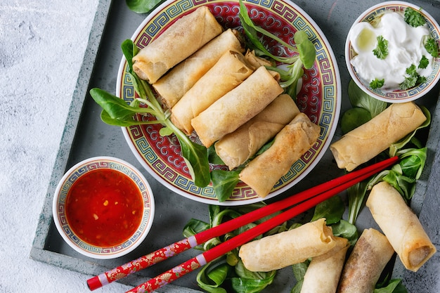 Fried spring rolls with sauce Premium Photo