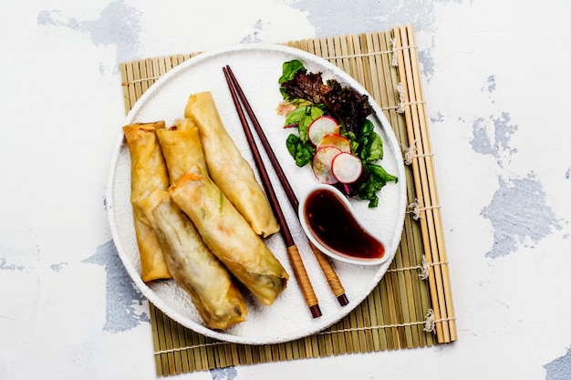 Fried spring rolls with vegetables, duck meat and noodle Premium Photo