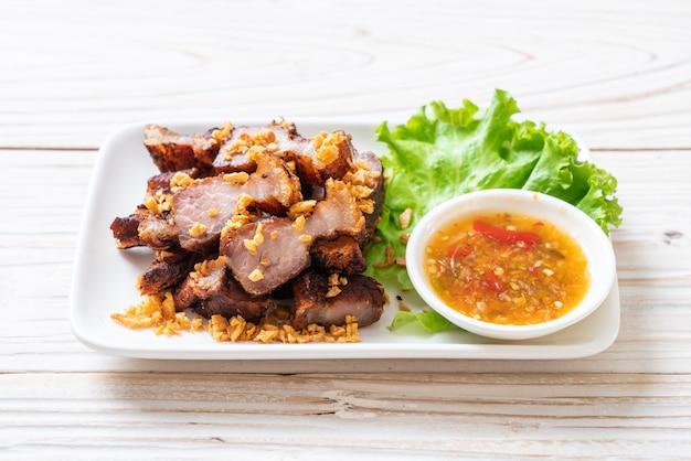 Fried streaky pork or crispy pork or deep fried pork belly Premium Photo