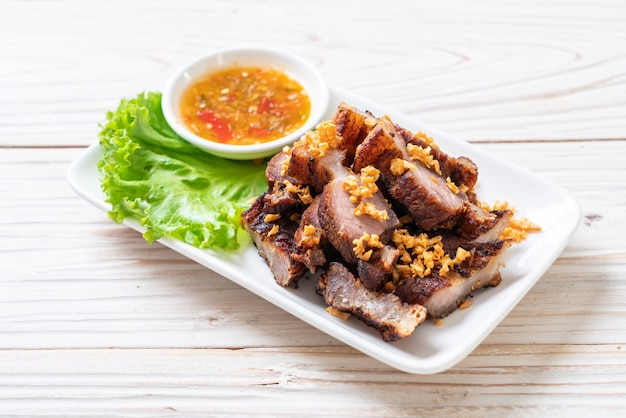 Fried streaky pork or crispy pork or deep fried pork belly Premium Photo