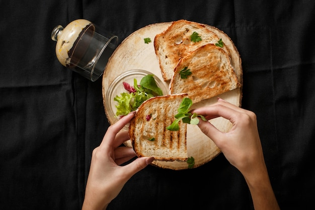 Fried toast with a can of pate on a wooden tray Premium Photo