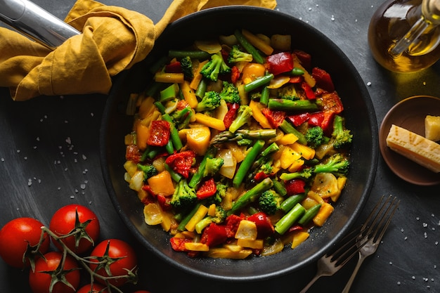 Fried vegetables with sauce on pan Free Photo