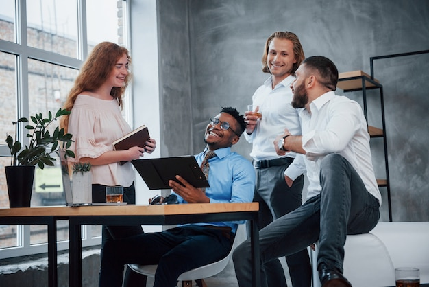 Friendly atmosphere. group of multiracial office workers in formal clothes talking about tasks and plans Premium Photo