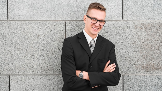 Friendly Businessman With Arms Crossed Photo Free Download