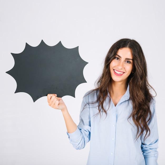 Friendly woman presenting speech bubble slate Free Photo