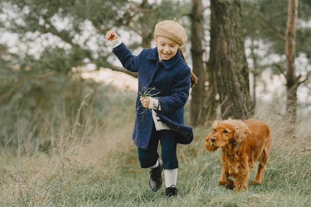 Friends are having fun in the fresh air. child in a blue coat. Free Photo