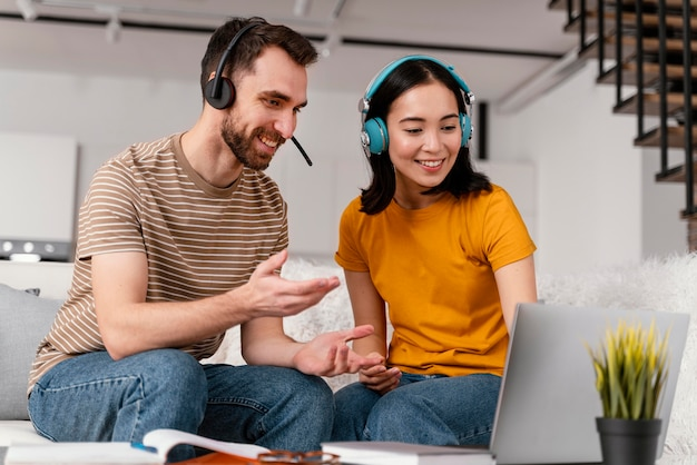 Friends attending online class together Free Photo