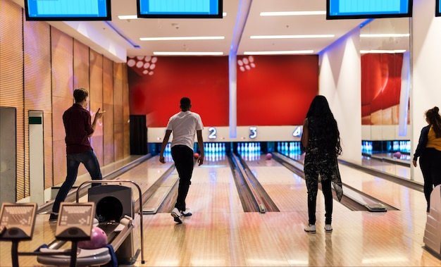 Friends at the bowling alley together Free Photo