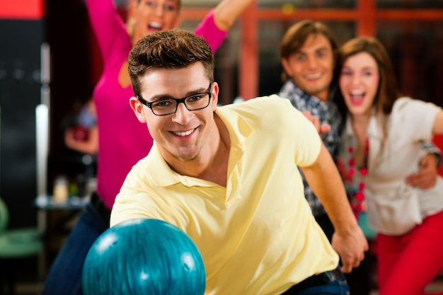 Friends bowling together Premium Photo