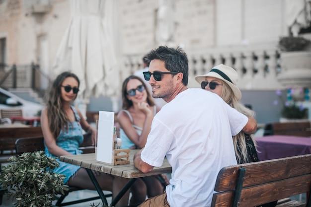 Friends on a café's terrace Premium Photo