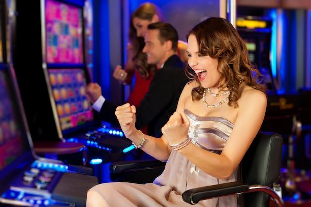 Friends in casino Premium Photo