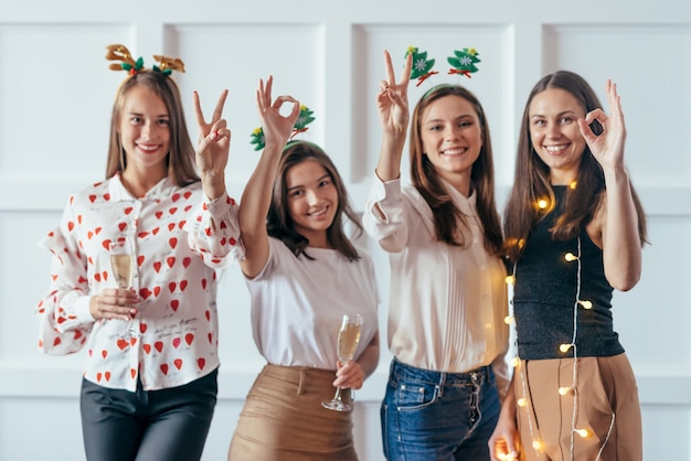 Friends celebrating christmas or new year eve party showing gestures 2020. Premium Photo