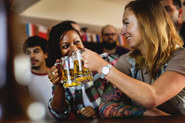 Friends cheering sport at bar together Premium Photo