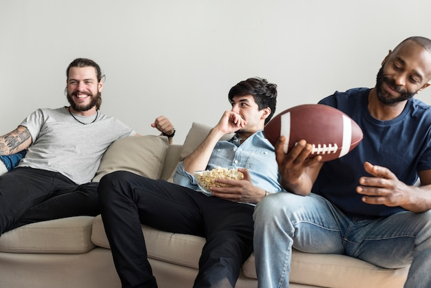 Friends cheering sport league together Premium Photo