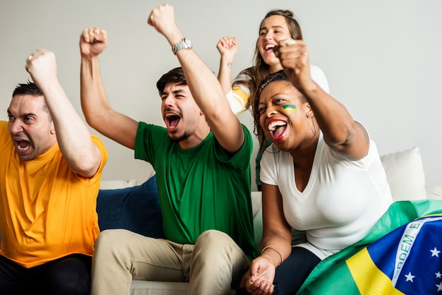 Friends cheering world cup with painted flag Premium Photo