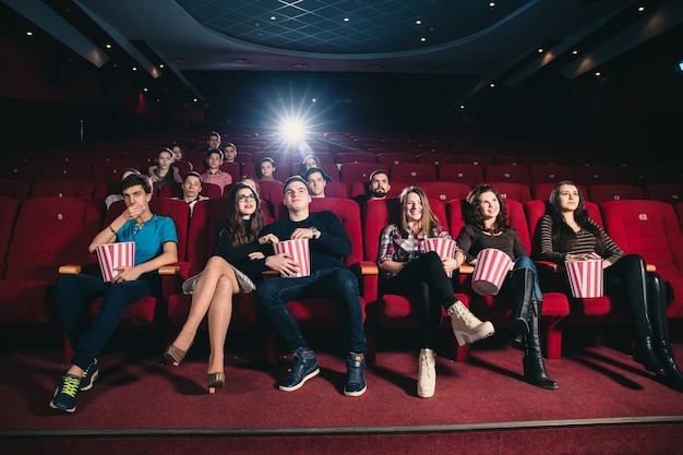 Friends in a cinema theater at an interesting movie session Premium Photo