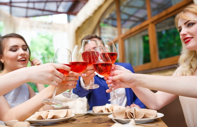 Friends drinking wine on the summer terrace. Premium Photo