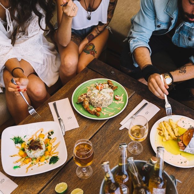 Friends Eating In Restaurant Photo Free Download
