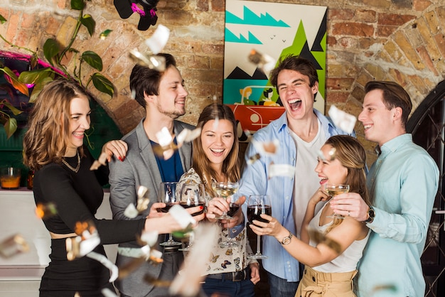 Friends enjoying party with toasting wine glass Free Photo