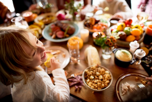Friends and families are gathering on thanksgiving day together Premium Photo