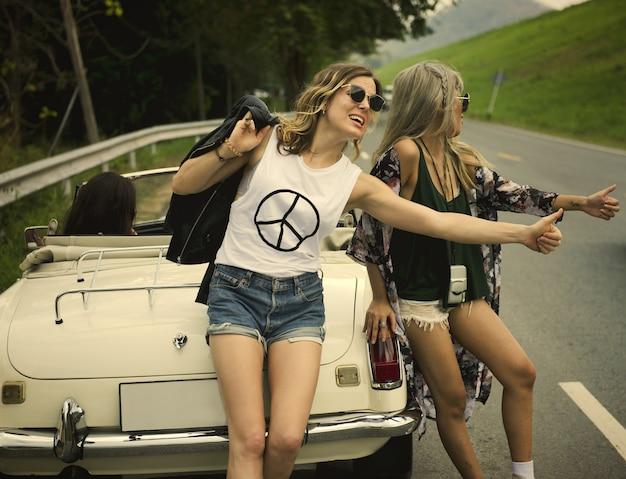 Friends on a fun and crazy road trip Premium Photo