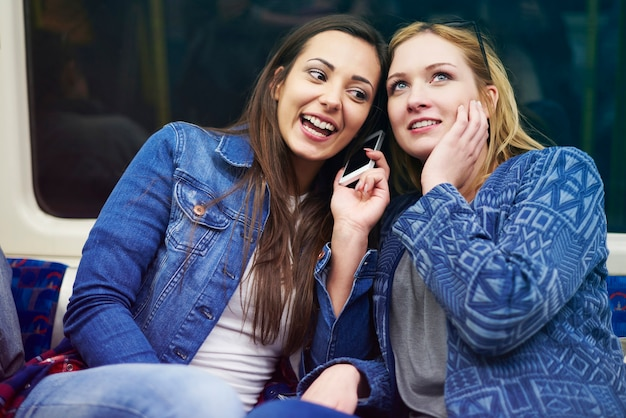 Friends gossiping in the underground Free Photo