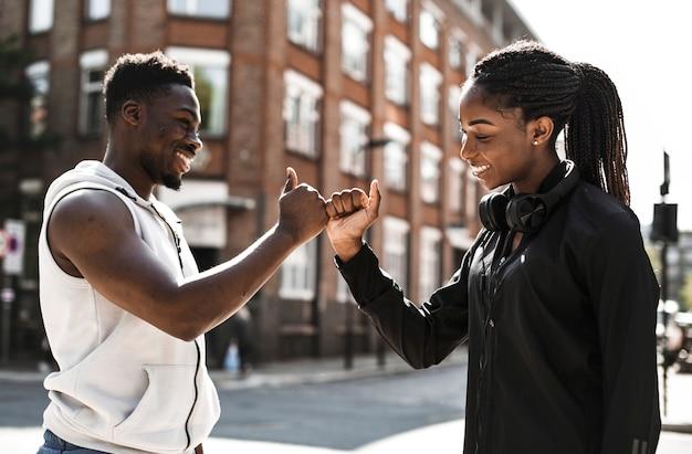 Friends greeting with a signature handshake Premium Photo
