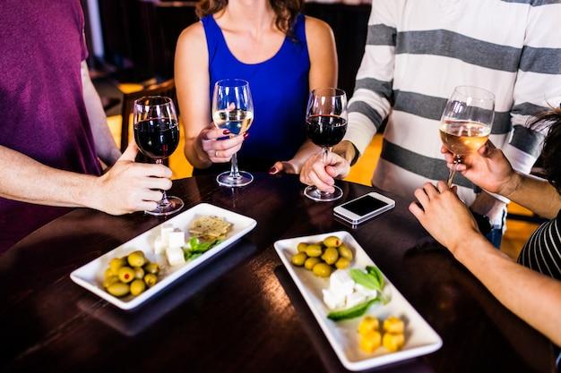 Friends having an aperitif with wine in a bar Premium Photo
