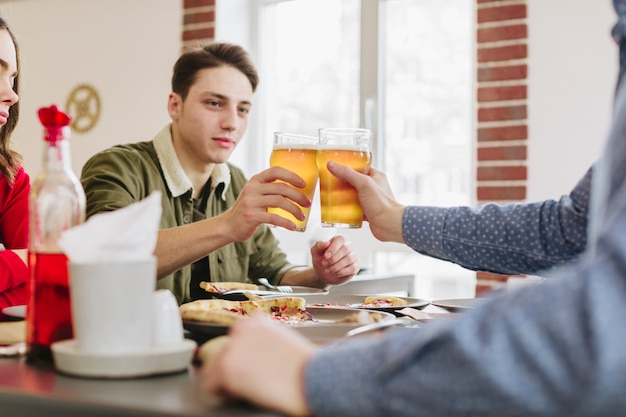 Friends having beer in a restaurant Free Photo