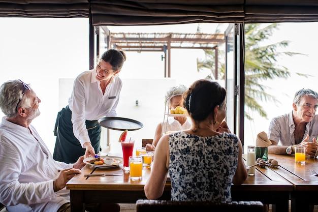 Friends having breakfast at a hotel Premium Photo